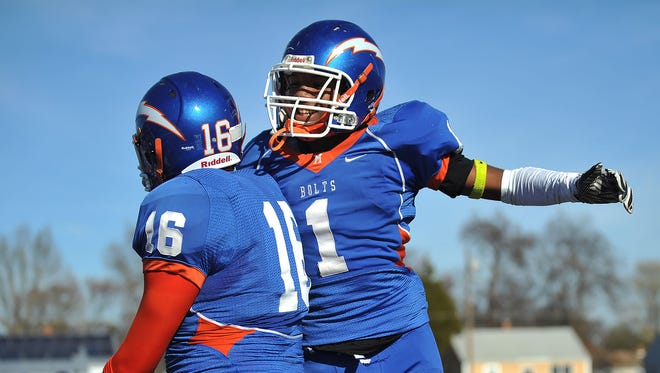Millville's Carlton Lawrence (1) and Will Polhamus (16) celebrate a 21-20 win over Vineland on Thursday.