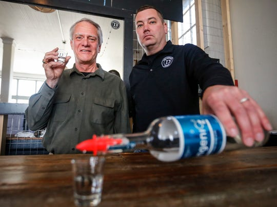 J. (Hans) van Leeuwen, CEO and Founder of OZ Spirits and Scott Dreher General manager at the Iowa Distilling Company in Cumming Friday, March 27, 2015.