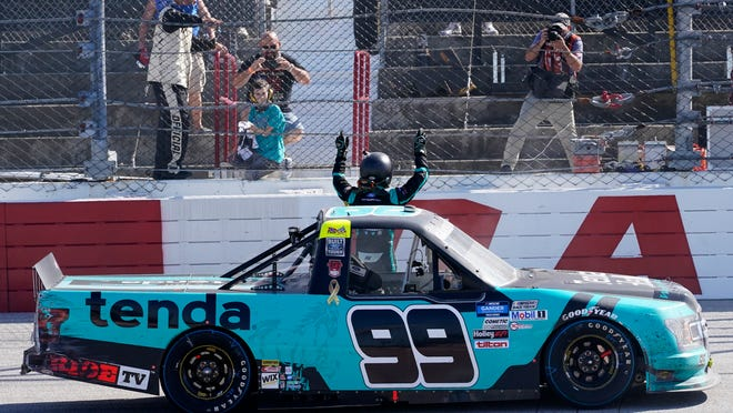 Ben Rhodes (99) celebrates after a win after a NASCAR Truck race Sunday, Sept. 6, 2020, in Darlington, S.C.