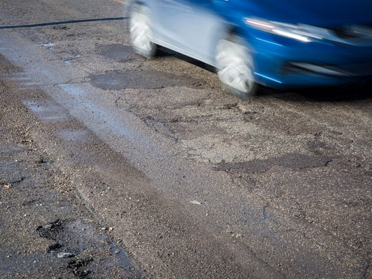 Large sections of patchwork and potholes plague a stretch