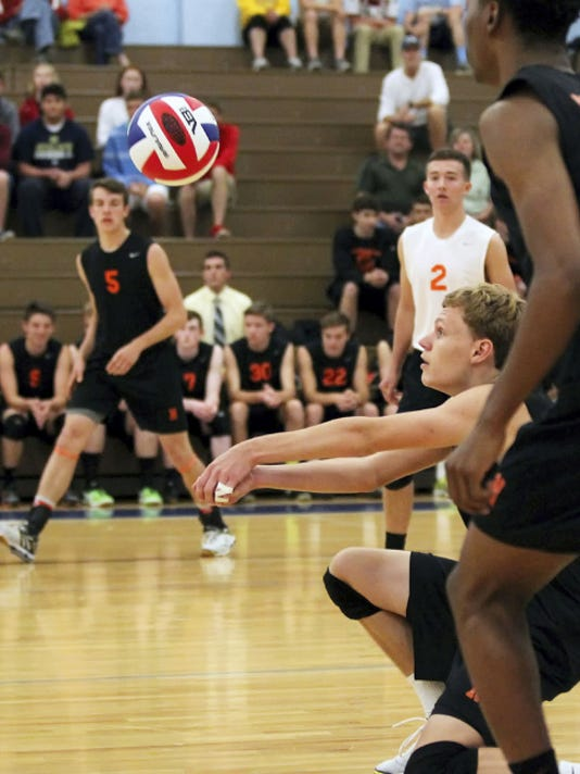 Northeastern's Brandon Arentz (23) digs the ball during a PIAA Class AA semifinal against Holy Redeemer on Tuesday at Exeter Township. The Bobcats won, 3-0.