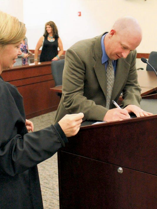 County Assessor Jimmy Voita is sworn in Thursday at the Eleventh Judicial District Court in Aztec.
