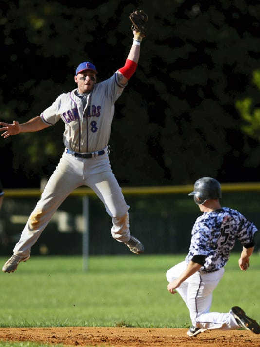 Conrads' Matt Jordan leaps to make a catch but is beat to the base by East Prospect's Devin Strickler during Game 1 of the Susquehanna League championship series in East Prospect on Tuesday. The Pistons took a 1-0 series lead with a 6-4 victory.