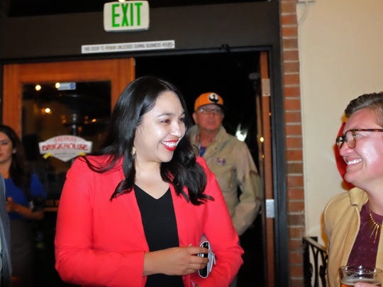 30th Assembly District candidate Karina Cervantez Alejo makes her entrance on Tuesday night to an election party at the Brickhouse in Salinas.