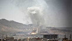 Smoke rises after a Saudi-led airstrike hit a site