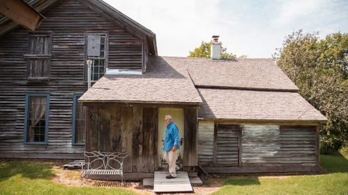 Jim Vivian, 74, steps out of a refurbished miner's house in the town of Central in Michigan's Upper Peninsula on Aug. 21, 2017.