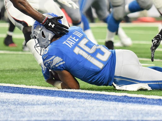 Lions wide receiver Golden Tate makes a reception that