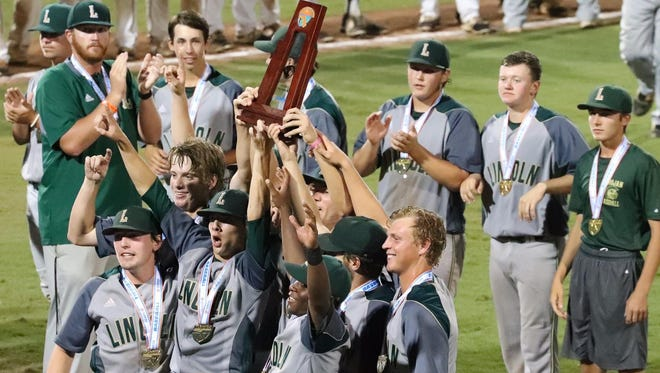Lincoln's seniors hold the Class 8A state championship trophy after the Trojans' baseball team defeated Hagerty 5-1 on Saturday night at Hammond Stadium in Fort Myers.