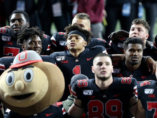 Oct 5, 2019; Columbus, OH, USA; Ohio State Buckeyes quarterback Justin Fields (1) celebrates with teammates after the game against the Michigan State Spartans at Ohio Stadium. Mandatory Credit: Joe Maiorana-USA TODAY Sports ORG XMIT: USATSI-404139 ORIG FILE ID:  20191005_lbm_mb3_336.JPG