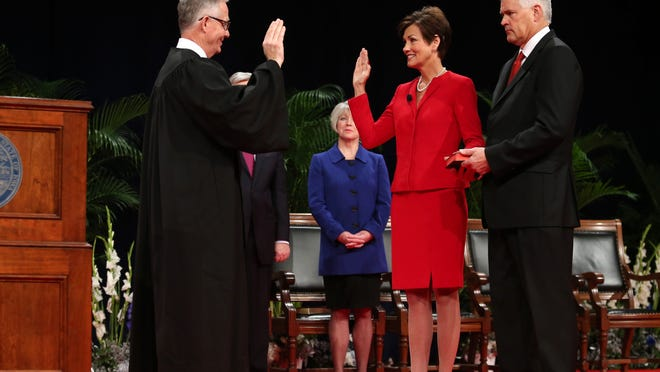 Lt. Gov. Kim Reynolds is sworn in by Iowa Chief Justice Mark Cady during the inauguration ceremony Friday in Des Moines.