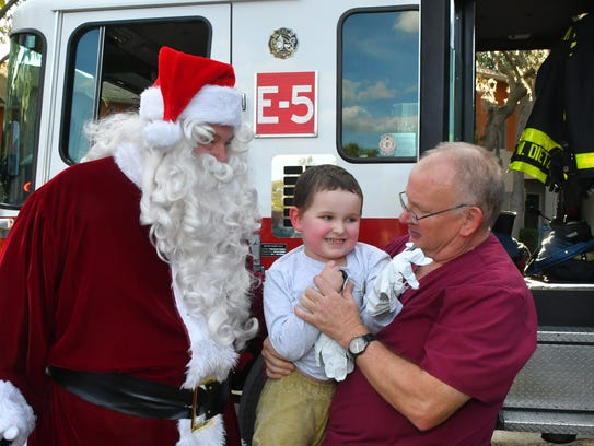 4 year old AJ Demarest, seen here with Santa and AJ's nurse Thane Bullock, R.N, got a surprise visit from Nick Swoboda and the rest of the crew of Station 5 of the Palm Bay Fire Dept. and Santa Claus. AJ suffers a rare form of muscular dystrophy as well as other health issues, and has braved many hospital stays and treatments. His Facebook page is AJ's Platoon.