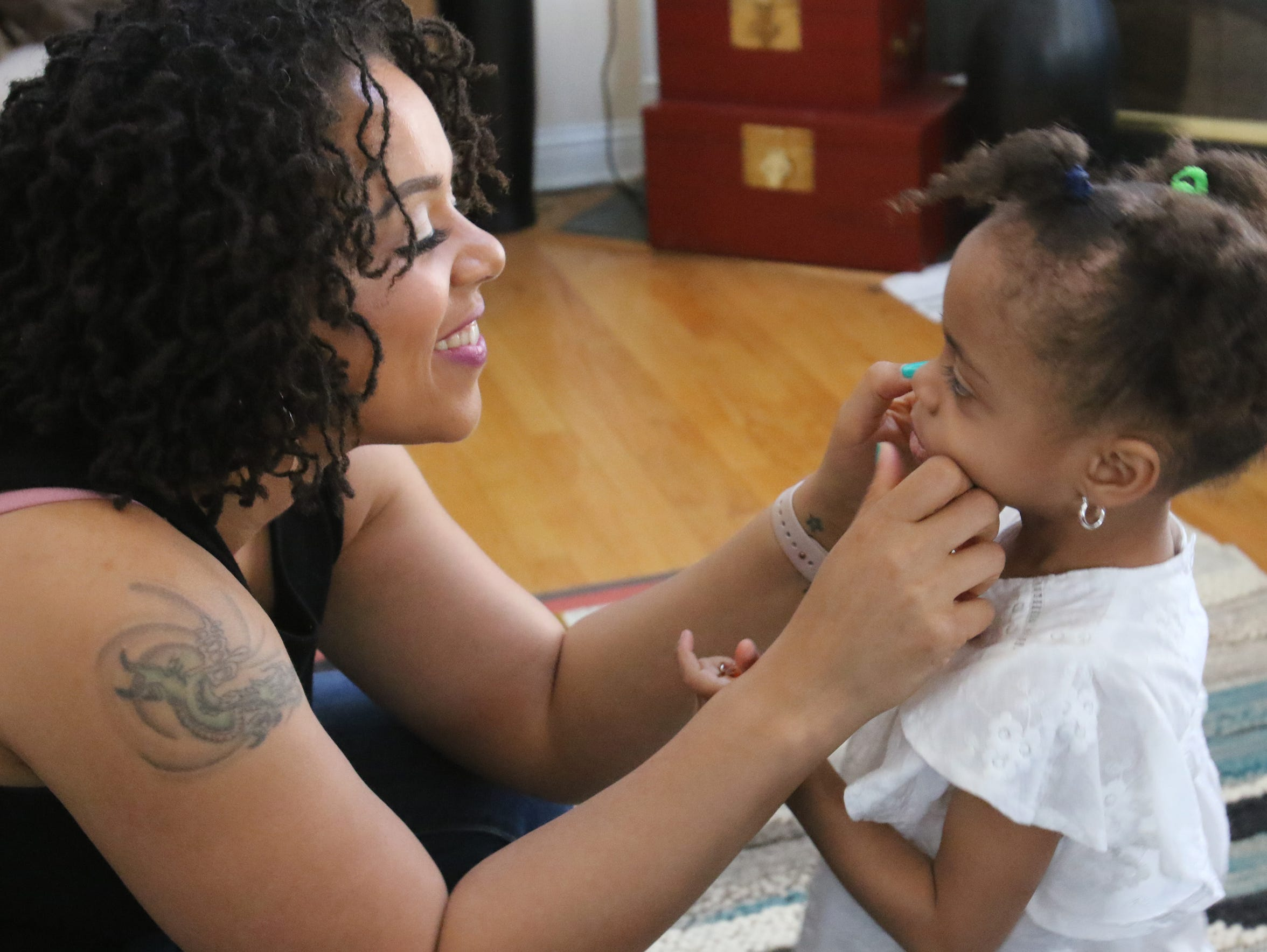 Melissa Goins with daughter Evelyn Islam, 2, in the