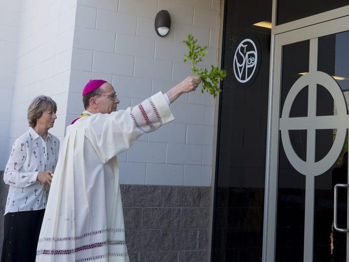Bishop Thomas Olmsted blesses St. Vincent de Paul's