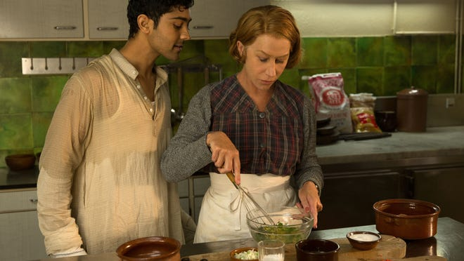 "THE HUNDRED FOOT JOURNEY  When Hassan Kadam (Manish Dayal) and his family move from India to a village in the South of France, they open a restaurant and encounter Madame Mallory, (Academy Award®-winner Helen Mirren) the chef proprietress of a classical Michelin-starred French restaurant across the street. Cultures collide, but they eventually find common ground through their love of cooking, in DreamWorks Pictures' charming film, ""The Hundred-Foot Journey."" Based on the novel ""The Hundred-Foot Journey"" by Richard C. Morais, the film is directed by Lasse Hallström. The producers are Steven Spielberg, Oprah Winfrey and Juliet Blake.   HANDOUT Photo by François Duhamel, DreamWorks II Distribution Co., LLC.   ©2014 DreamWorks II Distribution Co., LLC. All Rights Reserved. ORG XMIT: 10/21/13 [Via MerlinFTP Drop]"