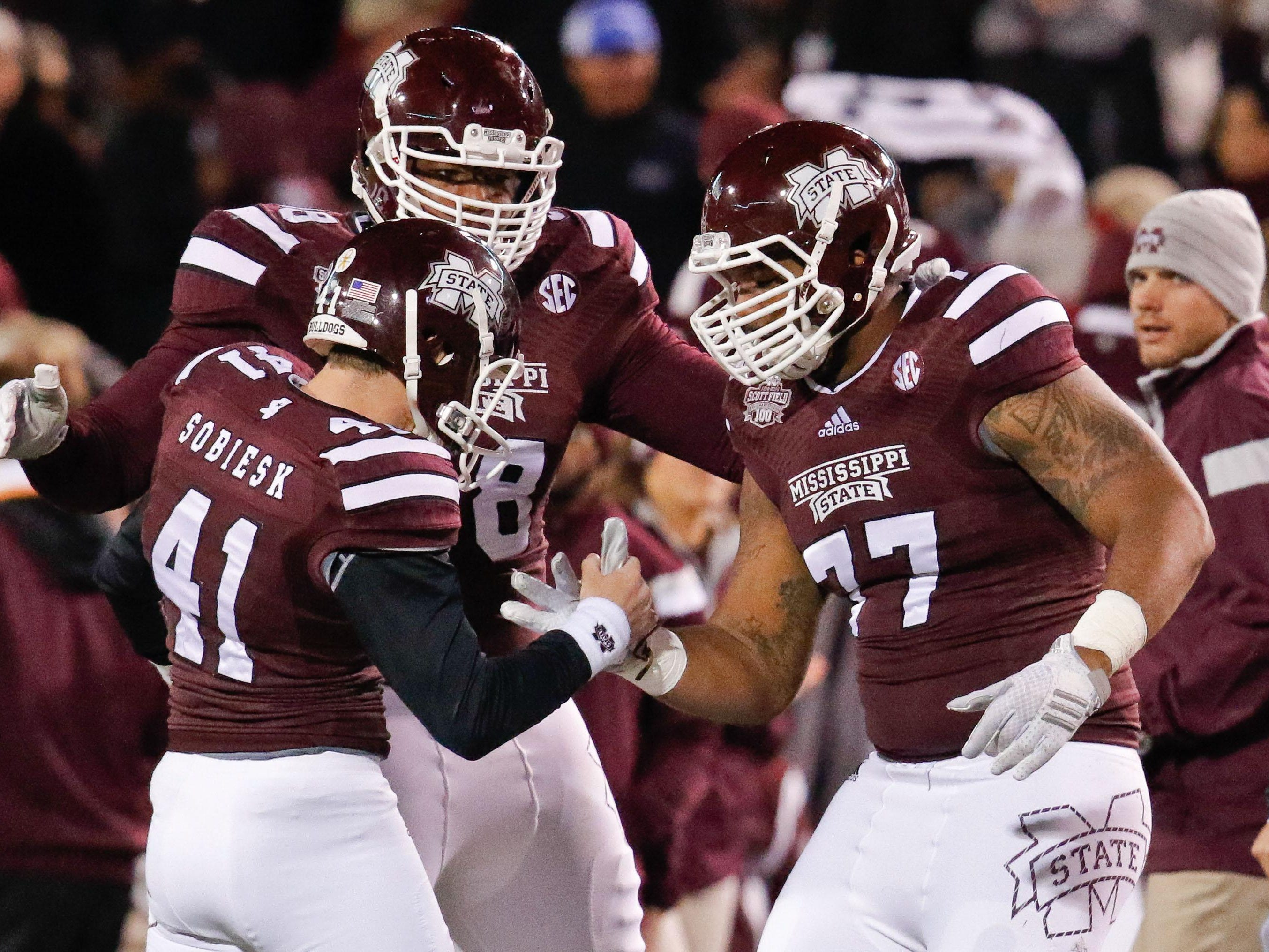 Rufus Warren (77) was once a tight end at Mississippi State and 235 pounds. Now 305 pounds, he will likely start at left tackle this year.
