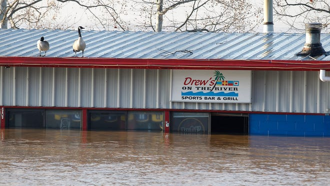 Drew's On The River Sports Bar and Grill at 4333 River Road, has water almost to the roof.