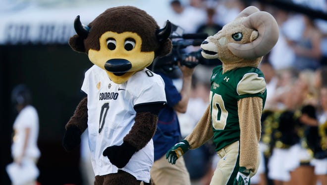 CU mascot Chip, left, and CSU mascot CAM the Ram head to midfield for the coin toss before the 2015 Rocky Mountain Showdown at Sports Authority Field.