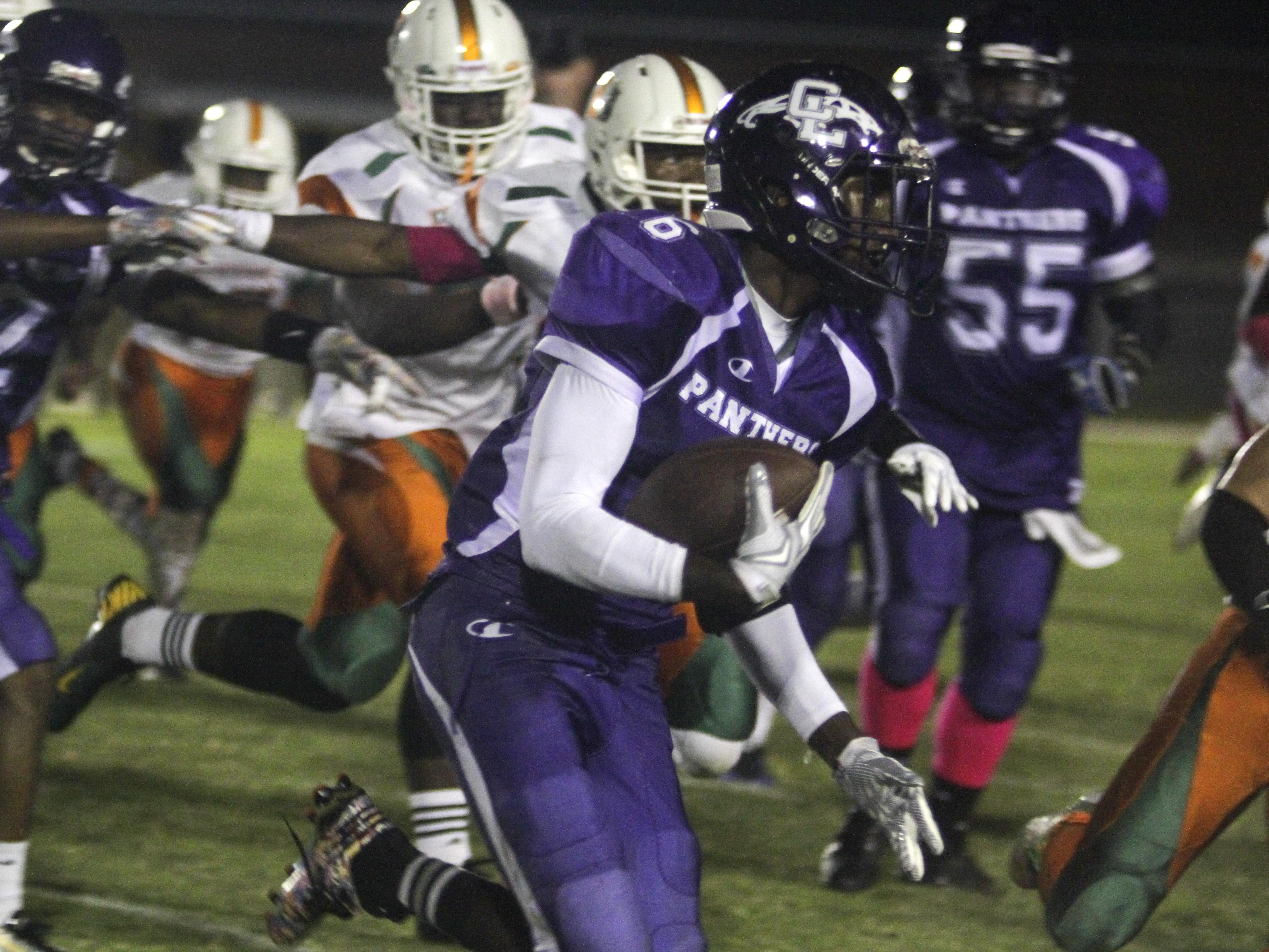 Cypress Lake's Yasir Abdullah runs the ball against Dunbar on Friday, October 16, 2015, in at Cypress Lake High School.