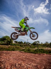 Lawrence Limtiaco, 12, has improved his motocross skills with a lot of practice.