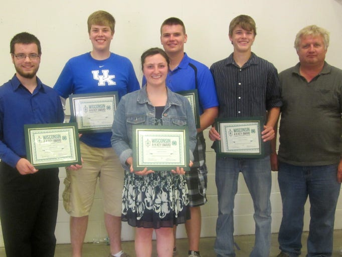 The Key Award is the highest state 4-H award and is earned by only two percent of 4-H members. Recipients are selected on their leadership and service throughout their 4-H career. From left: Zachary Doll, Mt. Calvary; Cole Tidemann, Rosendale; Valerie Kramer, St. Cloud; Zach Albert, Fond du Lac; and Casey Ruplinger, Mt. Calvary; and Brianna Gruenwald, Campbellsport (not pictured) all received the Wisconsin 4-H Key Award from Richard Julka, far right, president of FDL County Farm Bureau, on July 20 at the Fond du Lac County Fair. The Wisconsin Farm Bureau Foundation and its affiliate Rural Insurance Companies, have sponsored the Wisconsin 4-H Key Award Program since 1974.