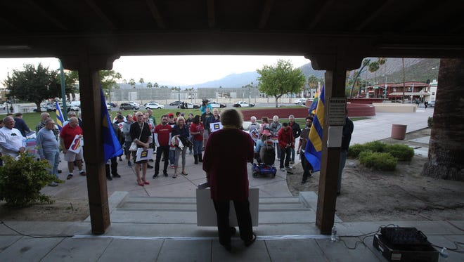 Members of the community come out to support transgender youth after President Trump's removal of transgender protection that requires schools to let students use restrooms based on their gender identities at Frances Stevens Park in Palm Springs on Thursday, February 23, 2017.