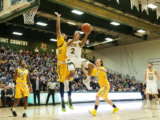 Catamounts guard Trae Bell-Haynes (2) leaps for a layup