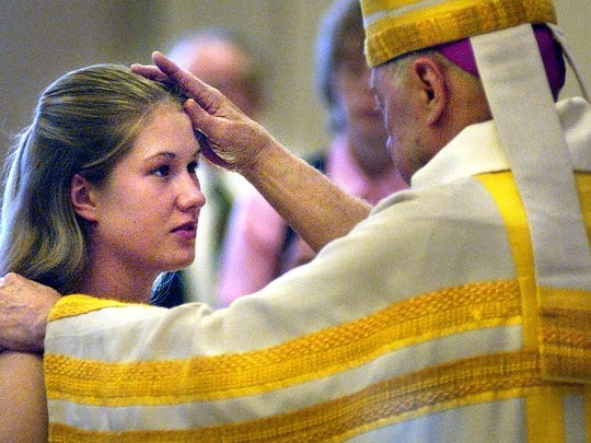 Cassy Preusser was one of 40 students to take part in a Confirmation Liturgy on May 8, 2004, at The Church of St. Augustine. The service was led by Bishop John Kinney.