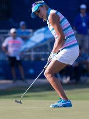 Lexi Thompson sinks a putt on the eighteenth hole during the CME Group Tour Championship at Tiburon Golf Club Thursday, Nov. 17, 2016 in Naples. Thompson finished the first round tied for nineteenth place with a score of one-under par.