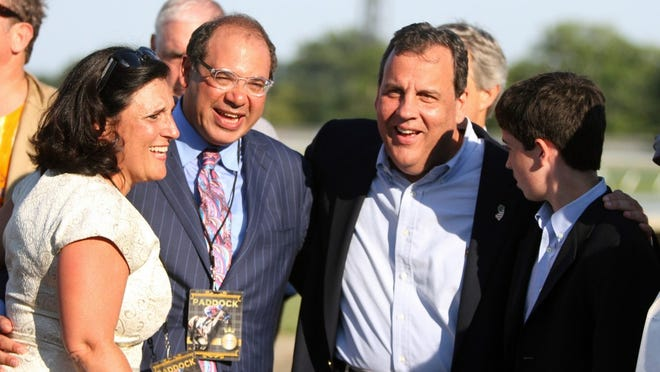 Ahmed Zayat, owner, and Gov. Chris Christie laugh together after American Pharoah won the 2015 William Hill Haskell Invitational at Monmouth Park in Oceanport, NJ Sunday, August 2, 2015. (Tanya Breen/Asbury Park Press)