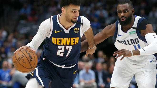 Denver Nuggets guard Jamal Murray (27) is making piano theme song videos during his downtime.