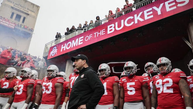 Ohio State coach Ryan Day prepares to lead the Buckeyes onto the field before a game against Wisconsin in October.