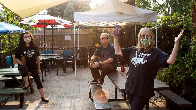 Ace of Cups owner Marcy Mays on the venue's patio with Carmen Ownens and Kyle Sowash.