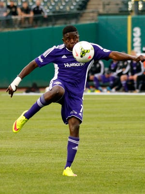 Louisville FC's Kadeem Dacres (7) shoots under pressure from Toronto FC's defense during their game at Louisville Slugger Field in Louisville, Kentucky.         May 16, 2015
