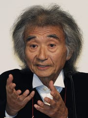 Seiji Ozawa speaks at a news conference in Tokyo in