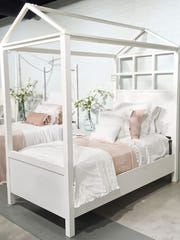 Magnolia Home, the furniture line by Chip and Joanna Gaines of HGTV, includes a Playhouse canopy youth bed that comes in a white or wood finish.