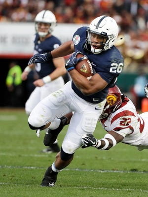 Penn State running back Saquon Barkley scores past Southern California defensive back Leon McQuay III during the first half of the Rose Bowl NCAA college football game Monday, Jan. 2, 2017, in Pasadena, Calif. (AP Photo/Gregory Bull)