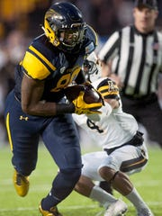 Toledo tight end Michael Roberts (80) breaks away from