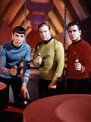 """Leonard Nimoy, William Shatner and James Doohan set their phasers on """"stun"""" in the original """"Star Trek"""" TV series, which premiered on NBC on Sept. 8, 1966."""