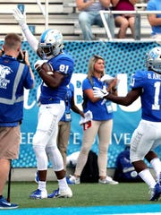 MTSU's CJ Windham (81) celebrates his touchdown against UT Martin as MTSU's Brad Anderson (11) comes up to congratulate him  takes on UT Martin during the game at MTSU on Saturday, Sept. 8, 2018.