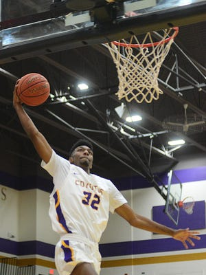 Kansas Wesleyan's Daekwon Gross (32) prepares to slam the ball during the first half against Dordt (Iowa) in Mabee Arena on Tuesday night.
