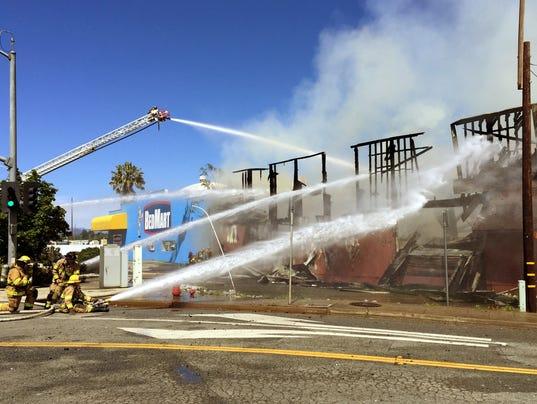 Fire destroys building next to BedMart in Redding