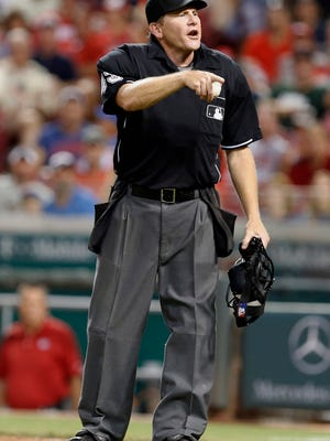 Umpire Paul Schrieber ejects Chicago Cubs catcher David Ross during a July 20, 2015, game in Cincinnati.