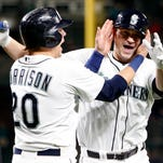 May 12, 2015; Seattle, WA, USA; Seattle Mariners catcher Mike Zunino (3) is greeted by first baseman Logan Morrison (20) after hitting a two-run homer against the San Diego Padres during the seventh inning at Safeco Field. Morrison scored on the play. Mandatory Credit: Joe Nicholson-USA TODAY Sports