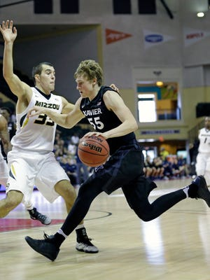 Xavier's J.P. Macura (55) drives to the basket against Missouri's Cullen VanLeer during the first half of the Tire Pros Invitational NCAA college basketball game, Thursday, Nov. 17, 2016, in Kissimmee, Fla.
