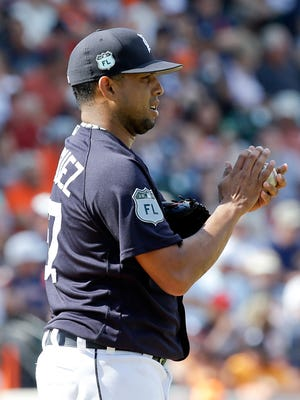 Detroit Tigers relief pitcher Francisco Rodriguez rubs the ball with his hands before throwing a pitch against the New York Yankees in a spring training baseball game Saturday, March 4, 2017, in Lakeland, Fla.