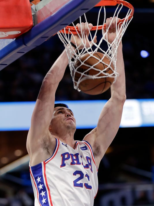 Philadelphia 76ers' Ersan Ilyasova makes an uncontested dunk against the Orlando Magic during the first half of an NBA basketball game, Thursday, March 22, 2018, in Orlando, Fla. (AP Photo/John Raoux)