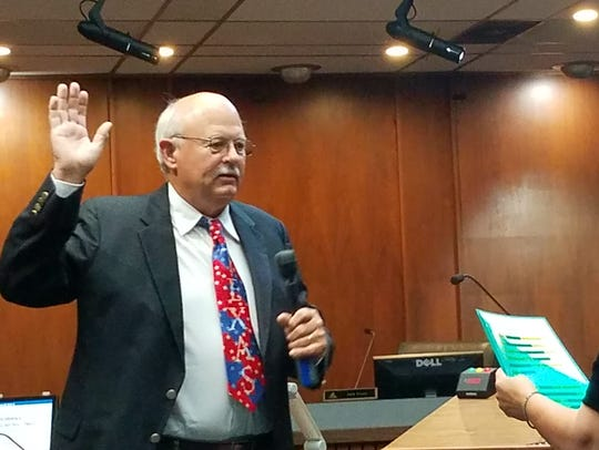 Jack Rentz is sworn in as Place 2 Abilene City Council member by City Secretary Rosa Rios on June 25. Rios has taken a similar job with the city of Denton.
