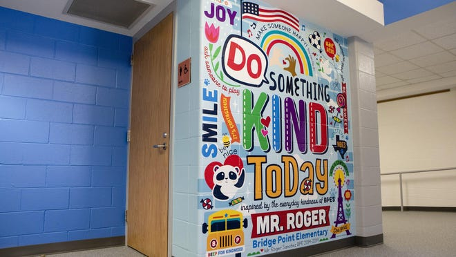 Eanes school district bus driver Roger Sanchez was honored this month with a mural. Sanchez, who was known for his kindness, died last year. The mural was painted in Bridge Point Elementary School's main hallway.
