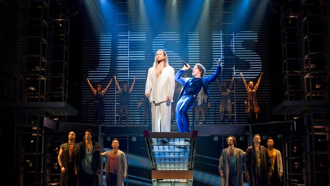 """Paul Nolan, center left, and Josh Nolan are shown with the cast during a performance of """"Jesus Christ Superstar"""" in New York."""