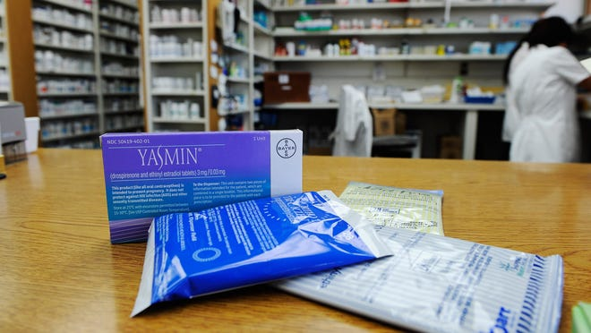 Prescription contraceptives for women sit on the counter of a drug store in Los Angeles.